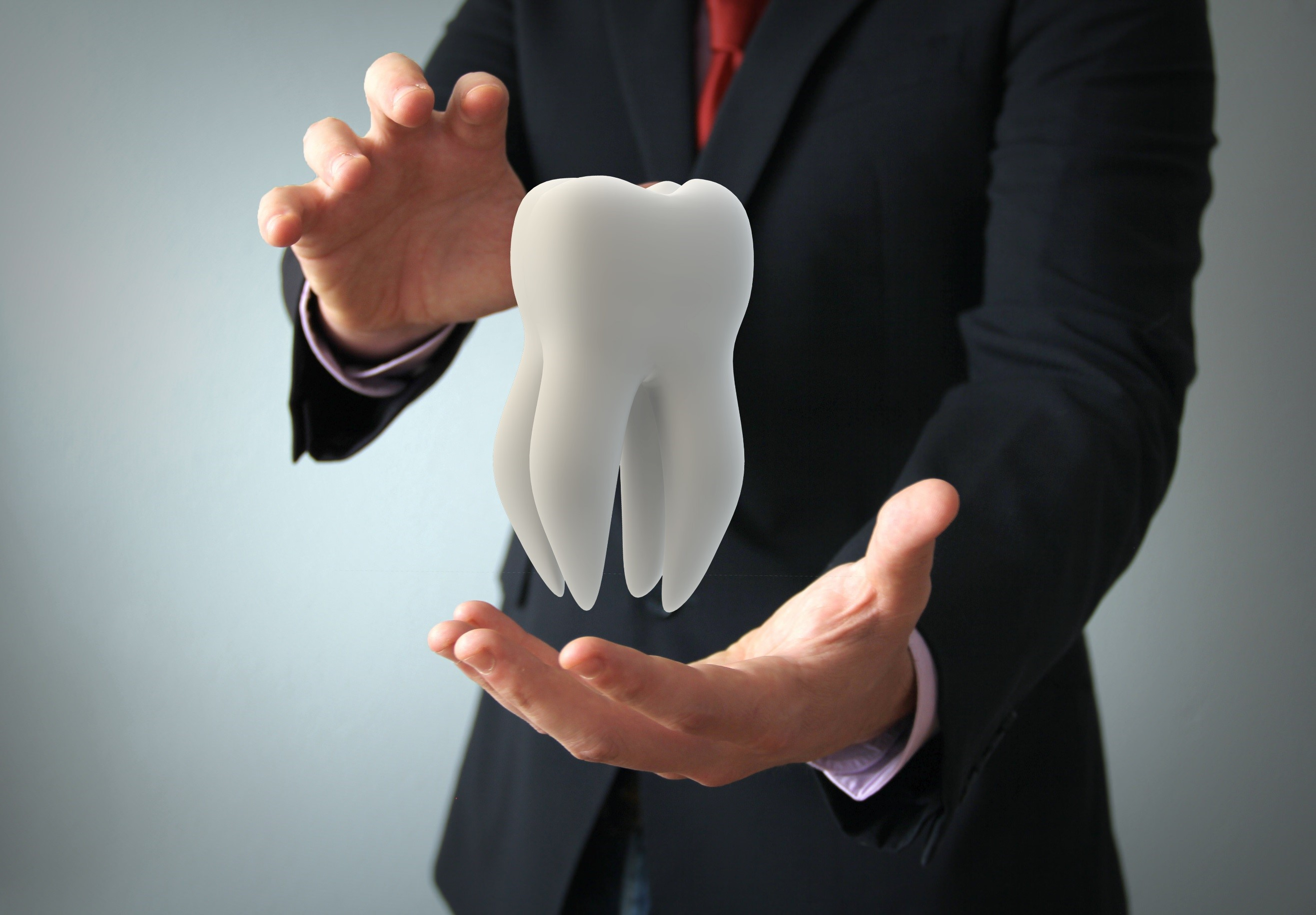 man in suit holding molar