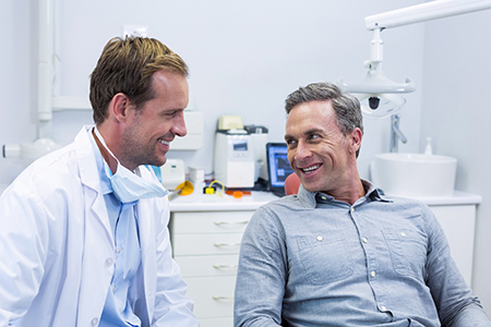 Implant dentist in Lake Wales smiling at a patient.