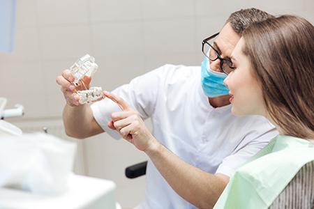 Implant dentist in Lake Wales explaining how dental implants work.